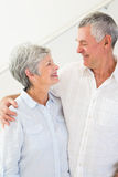 Happy retired couple standing and smiling at each other Royalty Free Stock Photography