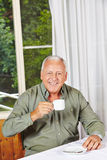 Happy retired man drinking coffee Royalty Free Stock Photography