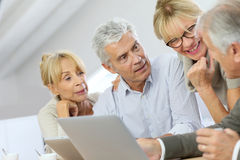 Happy retired people spending free time using tablet Royalty Free Stock Images