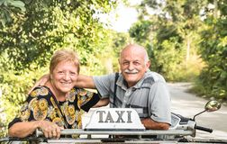 Happy retired senior couple taking travel photo at scooter taxi tour Royalty Free Stock Photos
