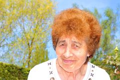 Happy retired senior woman stock image