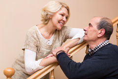 Happy retired spouses near stairs Royalty Free Stock Photos