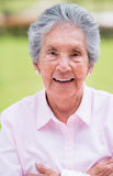Happy retired woman Stock Photography