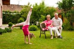 Happy retirement with grandchild Stock Images
