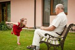 Happy retirement with grandchild Stock Photos