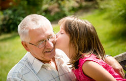 Happy retirement with grandchild Stock Images