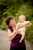 Happy retirement - grandmother with baby Royalty Free Stock Image