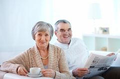 Happy retirement. Portrait of happy senior women and her husband at home Royalty Free Stock Photo