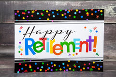 Happy Retirement. A happy retirement sign against a wood background stock photography