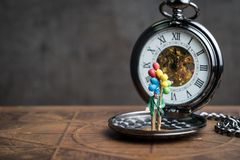 Happy retirement time countdown concept, senior old man holding. Balloons standing on vintage pocket watch in soft tone, can be use as good health of aged Stock Images
