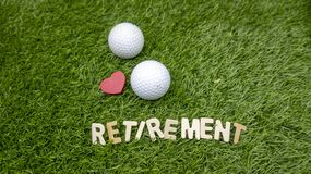 Happy Retirement to golfer with love and golf ball on grass Royalty Free Stock Images