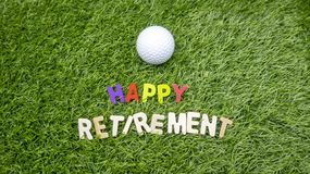 Happy Retirement to golfer with love and golf ball on grass Stock Photo