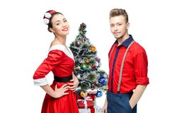 Happy retro couple near christmas tree Royalty Free Stock Photo