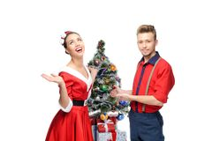 Happy retro couple near christmas tree Royalty Free Stock Image