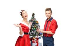 Happy retro couple near christmas tree Royalty Free Stock Image