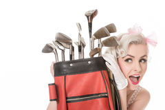 Happy retro girl peeking out from behind red golf bag, isolated Stock Photos