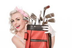 Happy retro girl peeking out from behind red golf bag, isolated Royalty Free Stock Photos