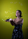 Happy retro girl is playing with bubbles Royalty Free Stock Images