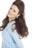 Happy Retro Girl. Sixties fashion woman in light blue outfit with retro hairstyle and makeup smiling over white background Stock Images