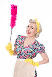 Happy retro housewife, with feather duster, isolated on white Stock Photography