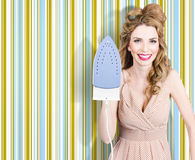 Happy retro housewife holding iron Stock Images