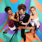 Happy retro rock band on a colored background Royalty Free Stock Photo