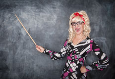 Happy retro teacher in glasses with wooden pointer Stock Photo