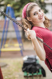 Happy retro woman swinging Royalty Free Stock Images