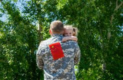 Happy reunion of soldier from China with family, daughter hug father