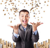 Happy rich businessman. Enjoying success throws up many coins isolated on white background Royalty Free Stock Images