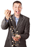 Happy rich businessman pouring coins Royalty Free Stock Photo