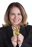 Happy rich businesswoman. Happy and rich businesswoman showing her gold dollar symbol necklace Stock Image