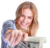 Happy rich girl. Portrait of cute happy girl holding in hand a lot american dollars, isolated on white background, spending money concept Royalty Free Stock Photo