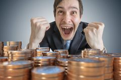 Happy rich man - millionaire wins money stock photography
