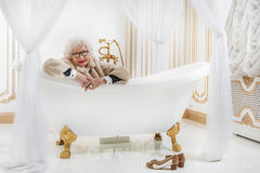Happy rich senior lady in bathroom Royalty Free Stock Photography