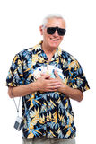 Happy rich senior tourist. With money, isolated on white background Stock Image