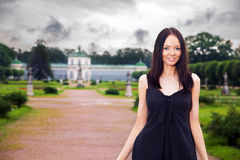 Happy rich woman. Happy beautiful woman walking in park of her estate Royalty Free Stock Photo