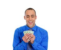Happy rich young man holding money dollar bills Stock Images