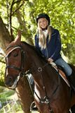 Happy rider on horseback Stock Images