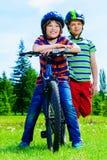 Happy riding bikes stock images