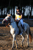 a happy riding girl Stock Photography