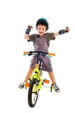 Happy riding new bike. Happy child riding his new bike on white studio background Stock Photography