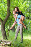 Happy riding young couple Royalty Free Stock Photo