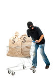 Happy robber with sack full of dollars Stock Image