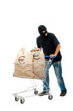 Happy robber with sack full of dollars Stock Photography