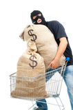 Happy robber with sacks full of dollars Royalty Free Stock Images