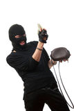 Happy robber takes money from stolen handbag. Stock Photo