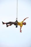Happy rock climber hanging on rope Royalty Free Stock Images