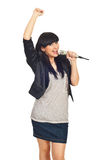 Happy rock girl sing in microphone. And raising her arm isolate don white background royalty free stock photography