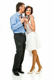 Happy romance. Happy young couple with wine glasses on white Royalty Free Stock Images